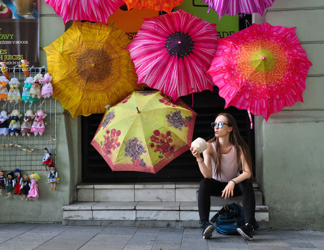Why not Coconut Cool Day Front View Leisure Activity One Person Outdoors Real People Rest Streetphotography Umbrella Women Young Adult Young Women