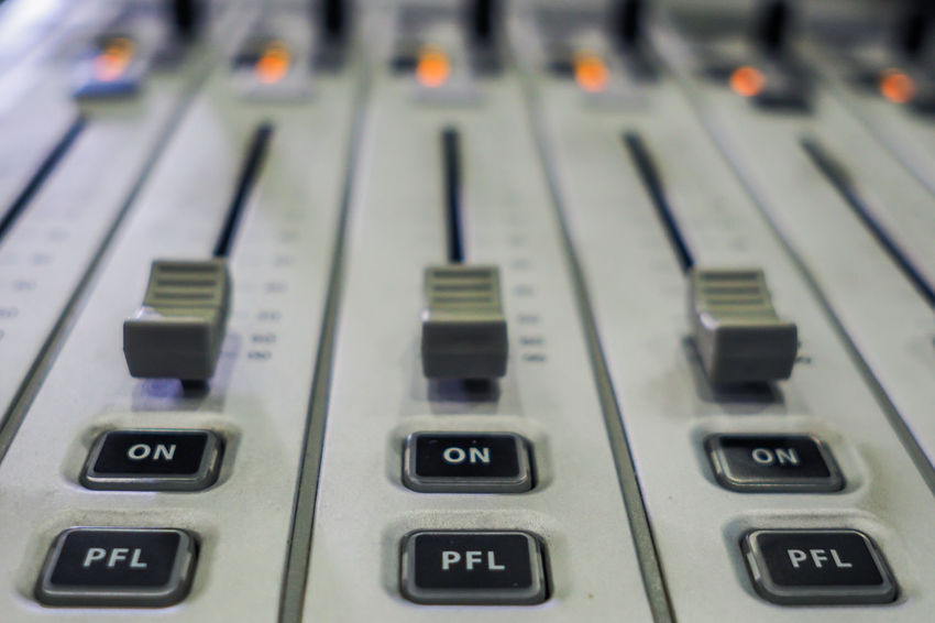 Audio Audio Equipment In Studio Radio Sound Audio Stream Audio Strean Broadcasting Buttons Close-up Day Fader In Radio Indoors  Mixer Mixer Audio Mixer Desk No People On Play Radio Mixer Radio Station Technology