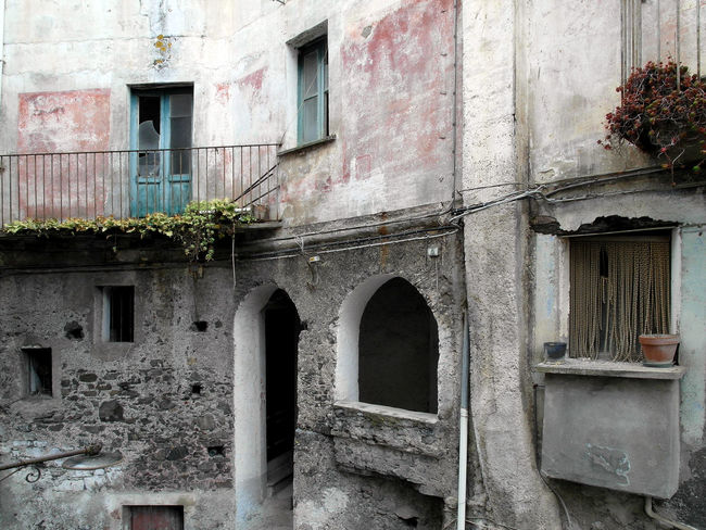 A glimpse of the historic center of Verbicaro with doors and windows Italia South Italy Abandoned Houses Arch Architecture Building Exterior Built Structure Calabria Door Glimpse House Outdoors Plant Verbicaro Window