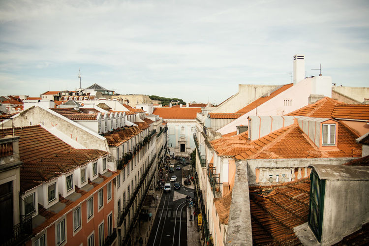 View from above across Lisbon city Cityscape Portugal Architecture Building Exterior Built Structure City Citylife Cloud - Sky Day High Angle View Lisbon No People Outdoors Residential Building Roof Sky Town View From Roof Top