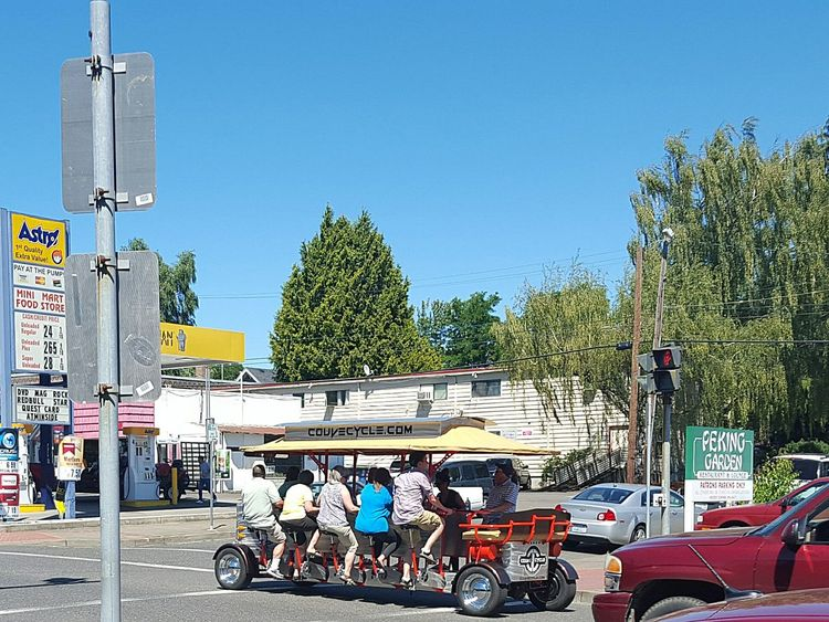 Couv Cycle down Main Street Mode Of Transport Land Vehicle Transportation City Street Pedal Power Pedalcar Pedal Pedalling Pedal Powered Unique Vehicles Summer Summertime Exercise Exploring The City Exploring The City Streets Pacific Northwest  PNW Washington State PNWonderland Vancouver, Washington Vancouver Washington Vancouver Sommergefühle Paint The Town Yellow Second Acts Be. Ready. Colour Your Horizn