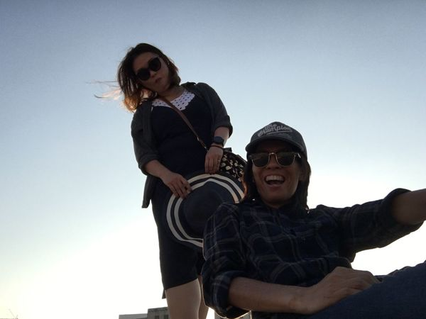Two People Togetherness Smiling Clear Sky Happiness Low Angle View Love Sky Bonding Day Lifestyles Men Cheerful Outdoors Real People Piggyback Young Adult Young Women Adult People Connected By Travel Connected By Travel