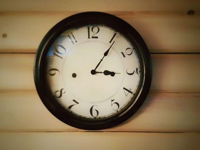 Close-up of clock at home