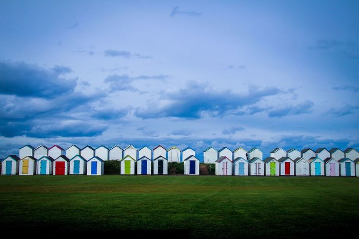 Beach huts at Broadsands. In A Row Sky Cloud - Sky Built Structure No People Day Outdoors Architecture Grass Nature Colour Colorful Colour Of Life Broadsands Torquay Paignton EyeEmNewHere Art Is Everywhere Break The Mold Beach Beachhuts Colors Colourful Devon Break The Mold The Architect - 2017 EyeEm Awards Neighborhood Map Live For The Story
