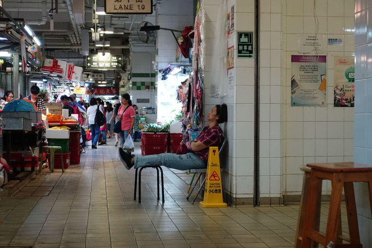 Hong Kong. Luen Wo Hui market. Wet Market Leisure Rest Annoyance Full Length Men Store Chair Architecture Built Structure