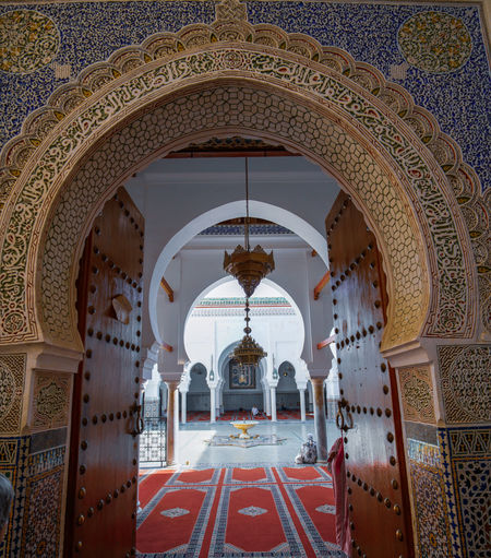 peaceful Travel Destinations Travel Photography Digital Nomad EyeEmNewHere Morocco Fes Morocco Architecture Arch Built Structure Building No People Indoors  Pattern Religion Text Place Of Worship History Day Ornate The Past Belief Tourism Arcade Architectural Column Ceiling Mural Arched Tiled Floor