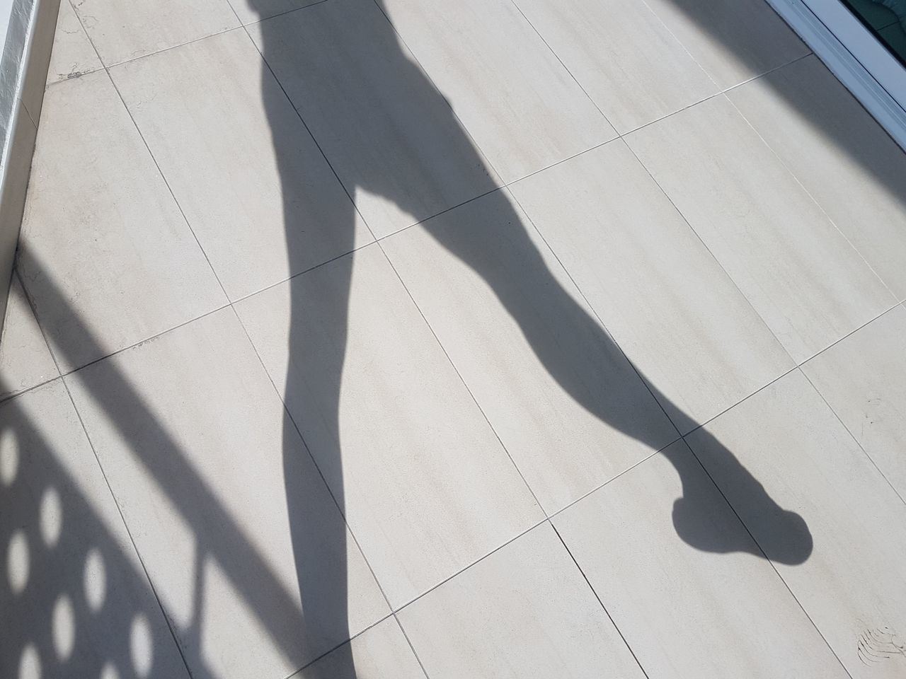 Shadow Of Woman Stretching