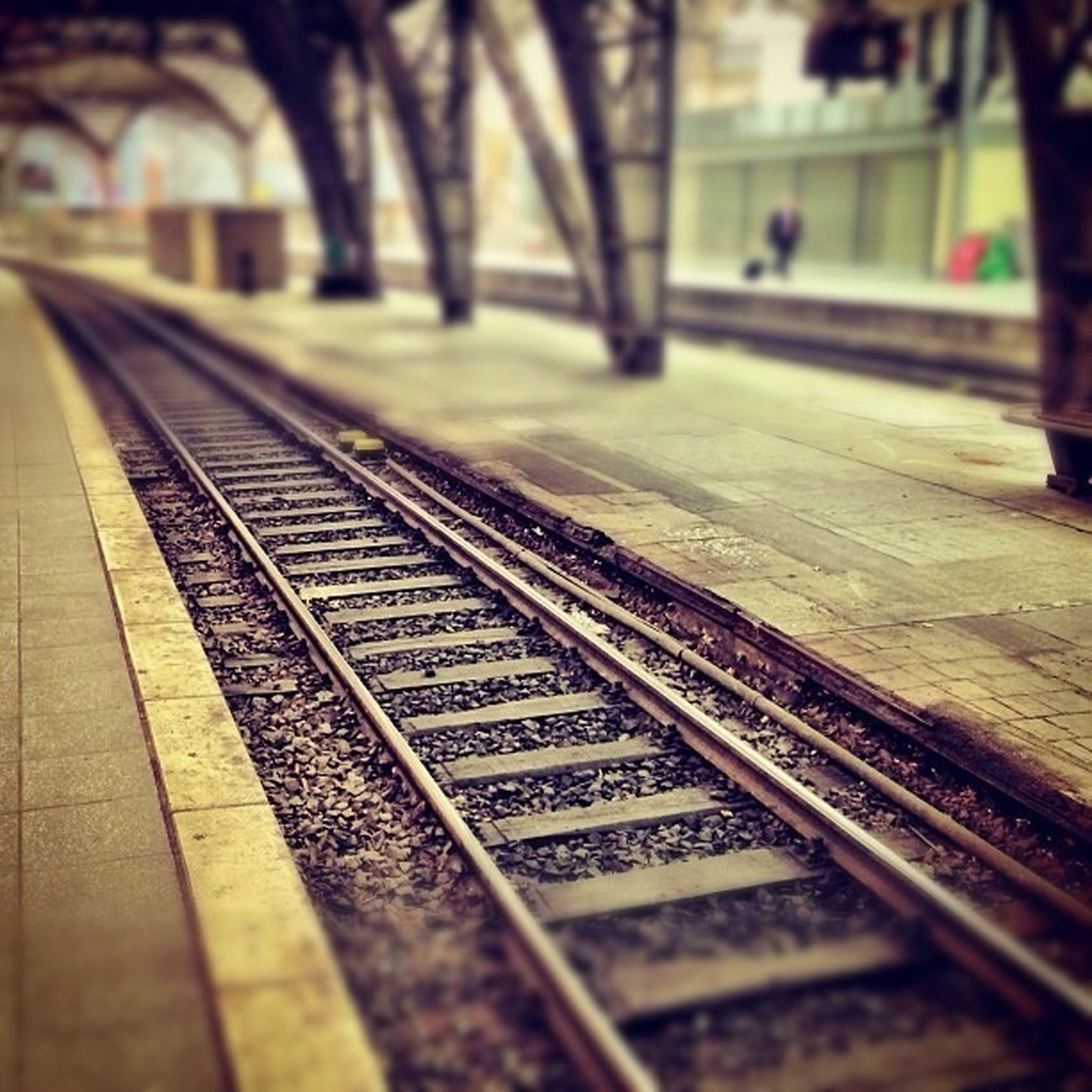 railroad track, transportation, rail transportation, public transportation, selective focus, railroad station platform, railroad station, focus on foreground, diminishing perspective, railway track, travel, surface level, metal, day, train, the way forward, train - vehicle, no people, public transport, close-up