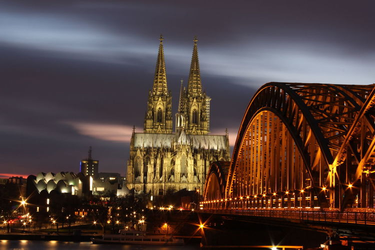 The Cologne Cathedral and the bridge over the Rhein river, in Cologne, Germany. Architecture Arts Culture And Entertainment Bridge - Man Made Structure Business Finance And Industry City Cityscape Cologne Dusk Germany Harbor Icon Illuminated Night No People Outdoors Sky Skyscraper Sunset Tourism Tower Travel Travel Destinations Urban Skyline Vacations Water An Eye For Travel The Traveler - 2018 EyeEm Awards The Architect - 2018 EyeEm Awards