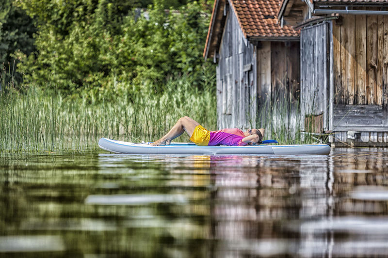 Woman relaxing on a standup paddle board Bavaria Bayern Calm Chiemsee Enjoy Germany Holiday Lake Meditation Moment Munich Nature Recreation  Relax Staffelsee Standup Paddleboarding Standuppaddle Standuppaddleboarding Summer Sup Surfer Tegernsee Tranquility Tranquility Woman The Great Outdoors - 2017 EyeEm Awards