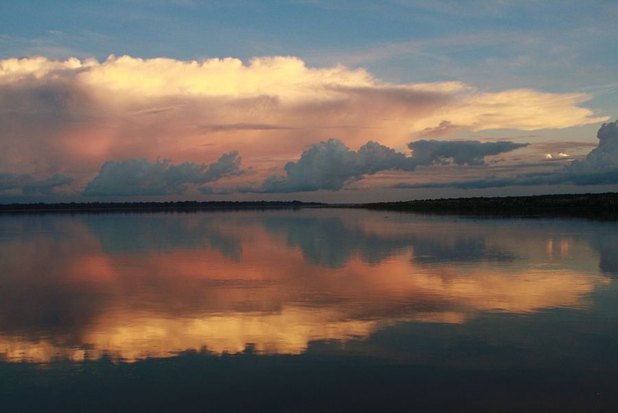 The most perfect reflection in the world... Amazon Amazonas Amazonriver Colombia Sunset Nature Reflection Beauty In Nature Scenics Tranquility Water Sky Cloud - Sky Idyllic Tranquil Scene No People Sea Outdoors Day Travel Travel Photography Travel Destinations This Week On Eyeem