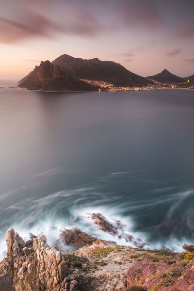 Cape Town Cape Town, South Africa City Lights City Lights At Night Coastline Hout Bay Hout Bay Beach Hout Bay Harbour Hout Bay Sunset Lion's Head Rocks Rocks And Water Sea Seascape Shore South Africa Sunset Table Mountain Travel Destinations Travel Photography Water