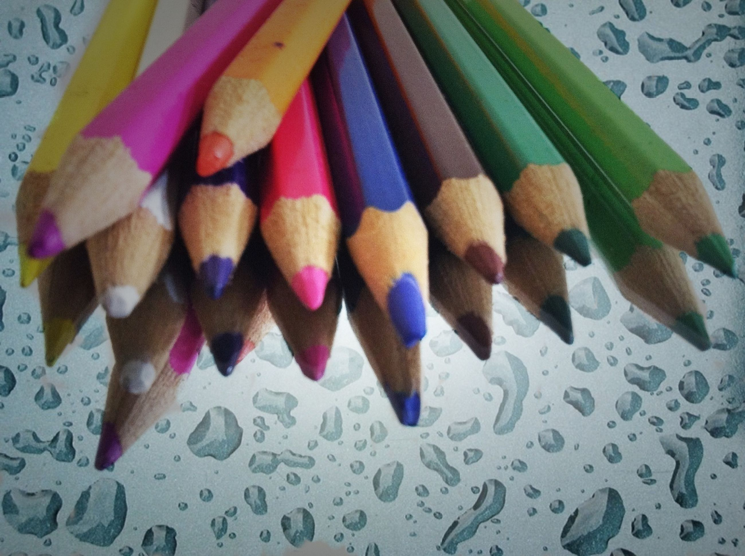 multi colored, variation, colorful, still life, indoors, close-up, large group of objects, blue, table, high angle view, art and craft, creativity, pencil, no people, choice, abundance, paper, group of objects, arrangement, pattern