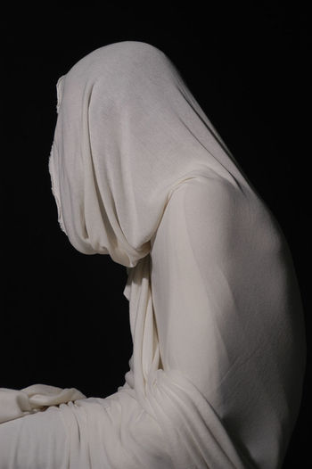 Rear view of woman standing against white background