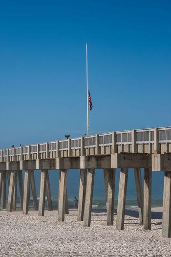 Clear Sky Dramatic Sky Pier Piercing Beach Beach Chairs Concrete Pier Concrete Pillar Day Florida Fog Foggy Foggy Morning Ocean Outdoors Sand Sand And Sea Sand And Surf Sea Oats Sky