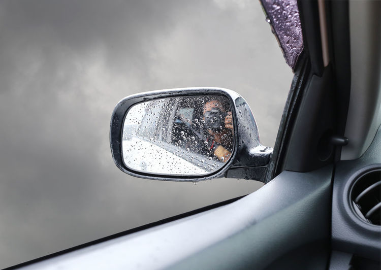 Side mirrors car with water is wet because of the rain falling on the overcast sky background. Car Car Interior Close-up Day Glass - Material Land Vehicle Mirror Mirrors Mode Of Transportation Motor Vehicle Nature No People Outdoors RainDrop Rainy Season Rear-view Mirror Reflection Side View Side-view Mirror Transparent Transportation Travel Vehicle Interior Vehicle Mirror Winter