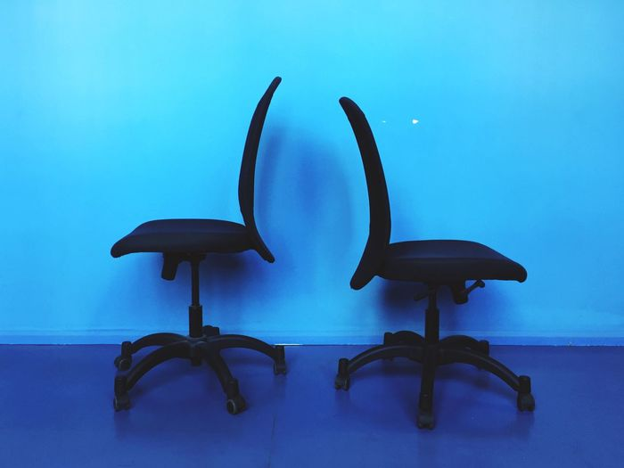Two chairs in blue room