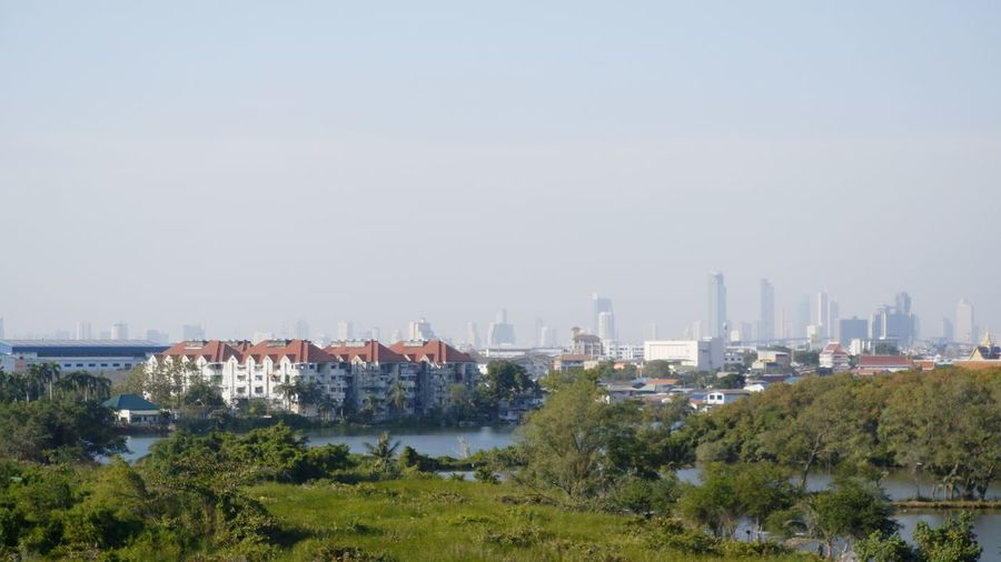 Panoramic view of city buildings against clear sky