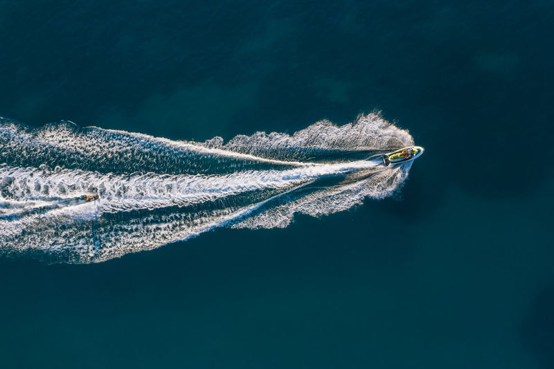 Aerial view of people jet boating in sea