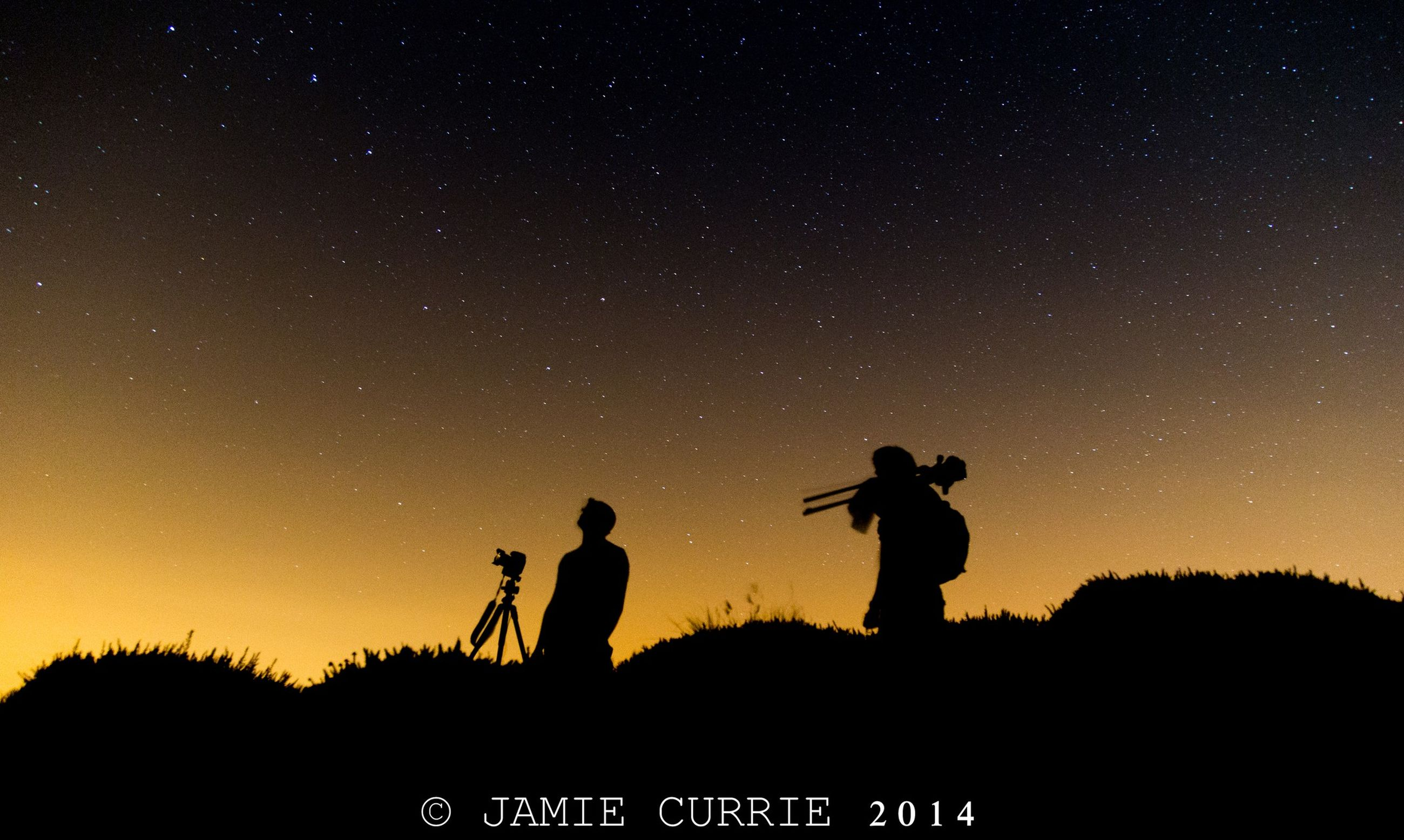 silhouette, night, leisure activity, men, lifestyles, standing, sky, dark, low angle view, beauty in nature, copy space, scenics, nature, unrecognizable person, togetherness, exploration, photographing