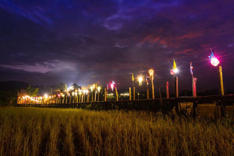 wooden bridge on rice field Rice Field Morning Twilight Sunset Silhouette Night Wooden Bridge Nightphotography Travel Thailand Illuminated Agriculture Field Sky Landscape