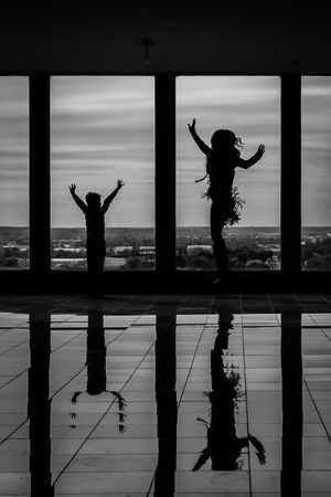Adult Arms Raised Day Females Full Length Human Arm Jumping Leisure Activity Lifestyles Mid-air Nature Outdoors People Positive Emotion Real People Reflection Silhouette Sky Water Women This Is Family Visual Creativity Focus On The Story Adventures In The City #FREIHEITBERLIN The Portraitist - 2018 EyeEm Awards