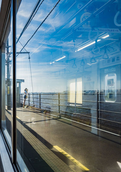 Glass - Material Window Transportation Transparent Mode Of Transportation Architecture Built Structure Travel Public Transportation Nature Sky Day Real People Reflection Sunlight Men Indoors  Vehicle Interior Railing Modern