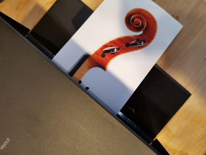 High angle view of piano on table