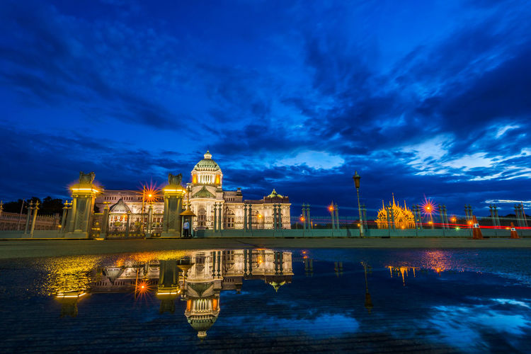 palace in Thailand on twilight time and reflection on water Politics And Government City Cityscape Water Dome Urban Skyline Place Of Worship Illuminated Reflection Sky Palace Pavilion Historic Tower Castle