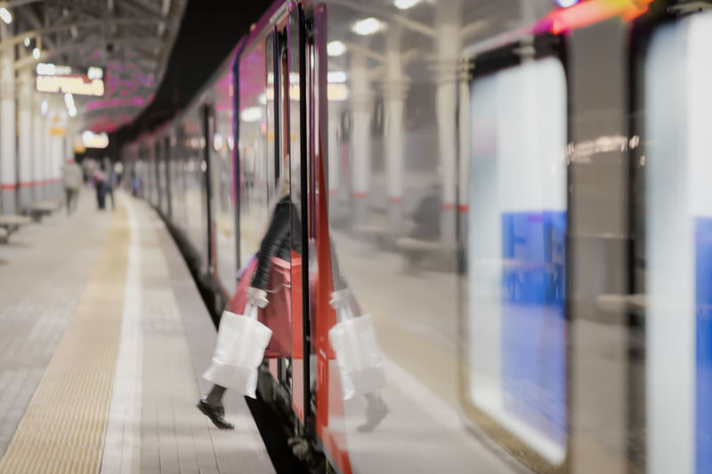 Low Section Of Woman Entering In Train