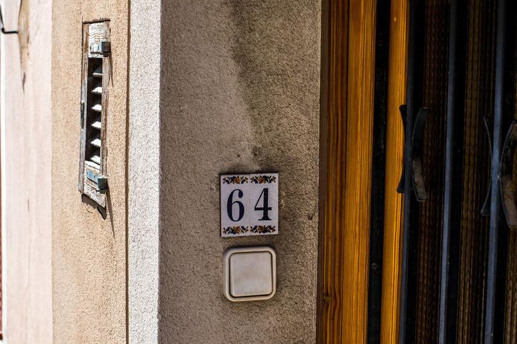 64 Andratx Architecture Building Exterior Built Structure Close-up Communication Day Door Door Number Majorca Mallorca No People Outdoors SPAIN