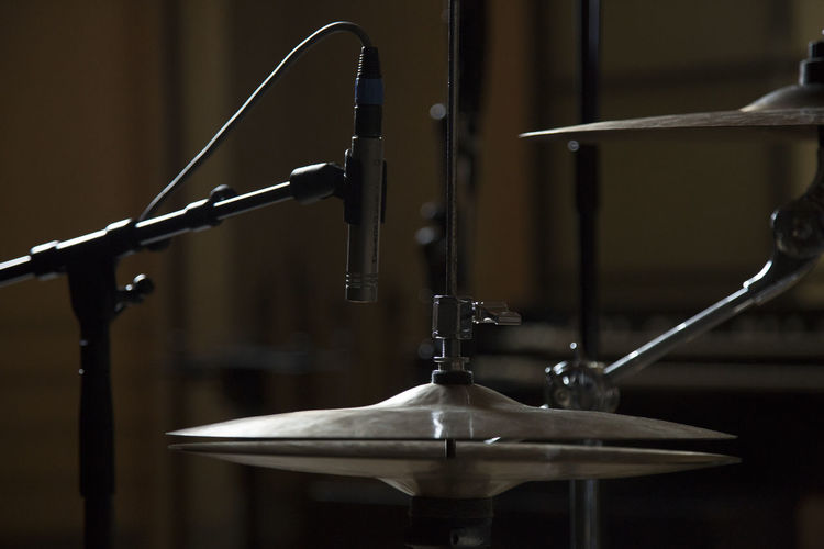 Close-up of cymbals in recording studio