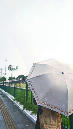 Low angle view of wet road against sky during rainy season