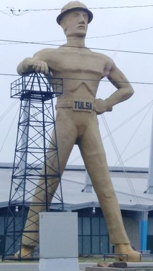 Tulsa's Golden Driller. Oil Rig Oil Industry Driller Statue Oil Derrick Symbol Sky Golden Driller Strength Tulsa, Oklahoma Stories From The City Full Length Business Finance And Industry Architecture Built Structure Human Representation Golden Color Male Likeness Sculpture
