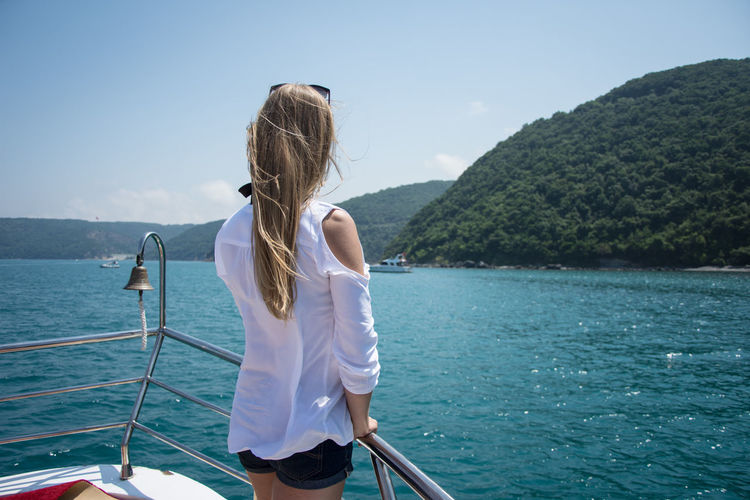 Istanbul Beauty In Nature Boat Boat Deck Clear Sky Leisure Activity Lifestyles Mode Of Transport Mountain Nature Nautical Vessel One Person Outdoors Real People Rear View Sailing Scenics Sea Sky Transportation Travel Destinations Vacations Water Women Young Adult