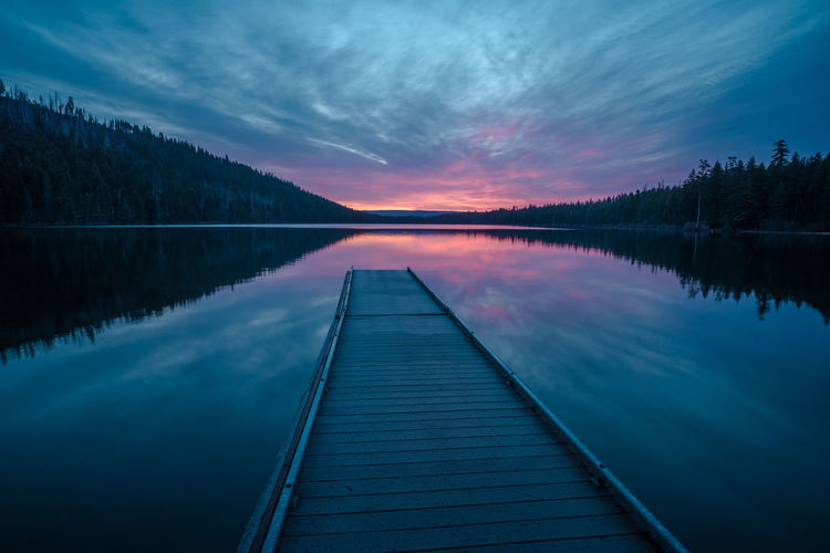 Scenic View Of Lake Against Sky At Sunset