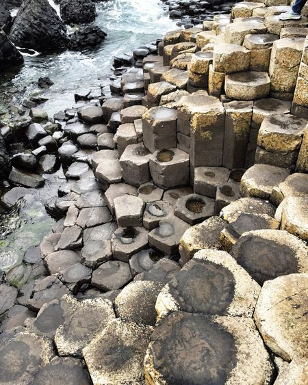 Komische Steine. Northern Ireland GiantsCauseway Stone - Object Rock Formation Water Geometry Stone Sea Ocean Shore Tranquility Scenics Beauty In Nature No People