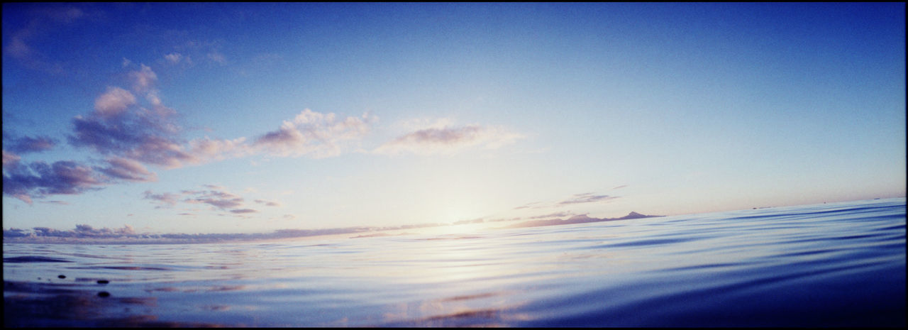 sky, scenics, beauty in nature, nature, tranquility, tranquil scene, sea, sunset, no people, outdoors, water, blue, horizon over water, day
