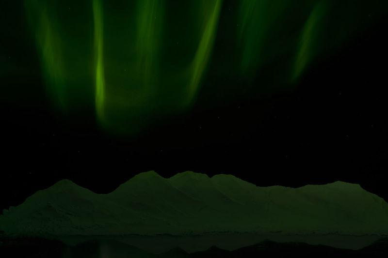 Full frame shot of illuminated water against sky at night