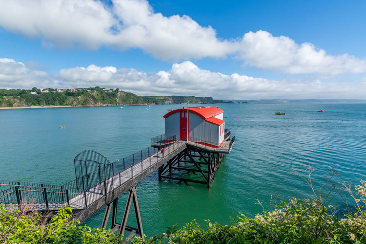 Old lifeboat station at Tenby Wales Holiday Tenby Tenby Harbour Architecture Bay Beauty In Nature Blue Built Structure Coast Day Dwelling Green Sea Lifeboat Station... Nature Old Lifeboat Station Outdoors Scenics Sea Sky Summer Tenby, Pembrokshire Tranquil Scene Tranquility Vacation Water