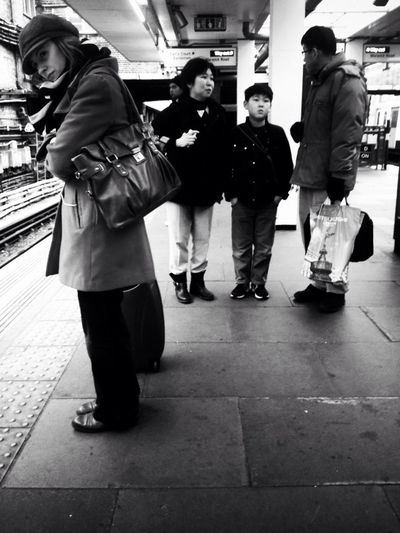 People standing at railroad station platform