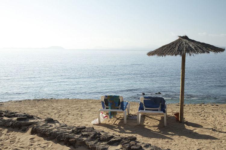 Lifeguard hut on beach against clear sky