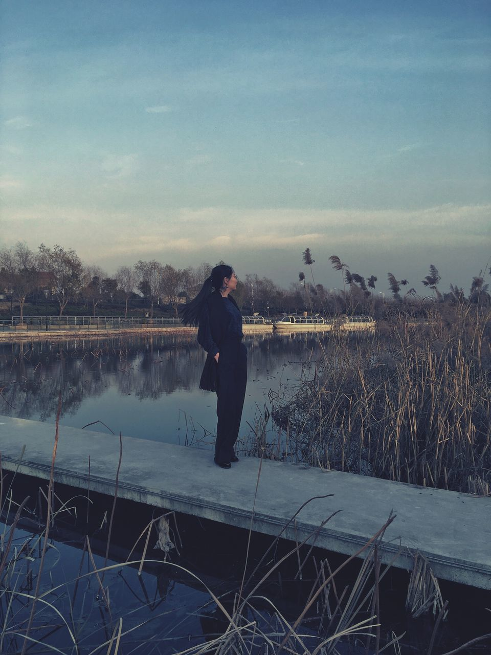 full length, one person, real people, sky, outdoors, nature, leisure activity, lifestyles, winter, standing, landscape, lake, plant, women, water, day, beauty in nature, cold temperature, tree, warm clothing, young adult, people