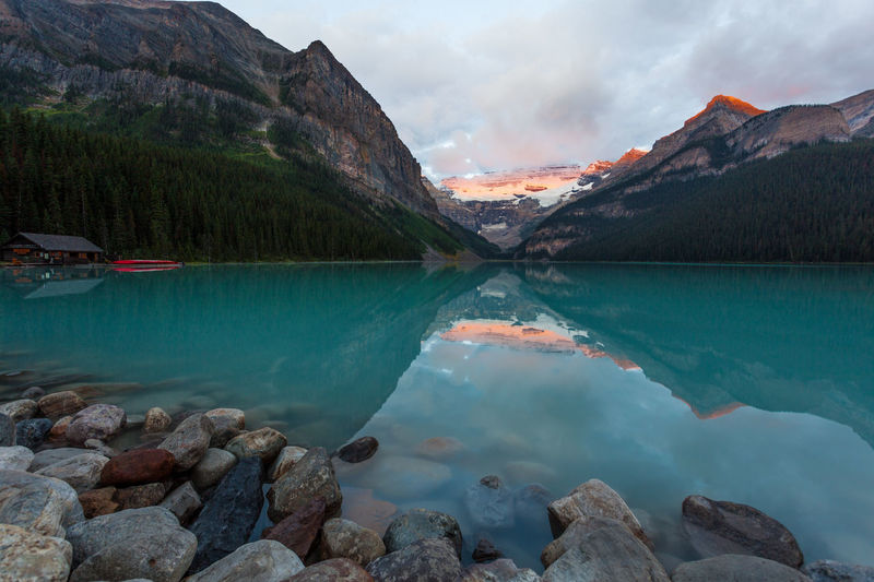 Morning glow on glacier over Lake Banff, Ontario, Canada Banff National Park  Canada Glacial Glacial Lake Glacial Water Glacier Glowing Lake Landscapes With WhiteWall Morning Mountain Range Mountains Ontario Rocky Mountains Sunrise Water Water Surface