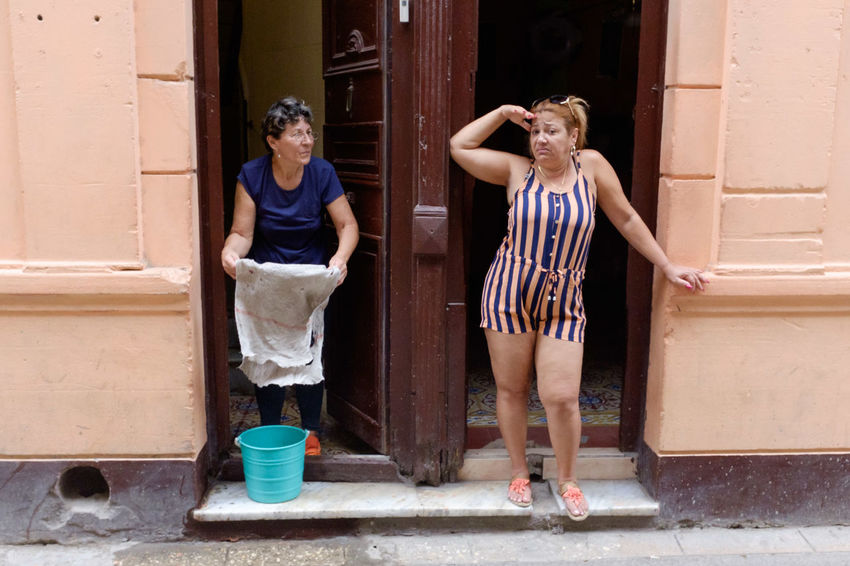 Streetphotography Street Photography Havana Cuba Young Women Full Length Togetherness Standing Water Doorway Domestic Life Candid Building Exterior Entryway Open Door Front Stoop Entry Porch Front Door Entrance