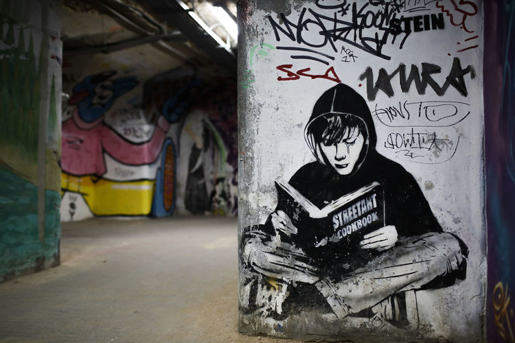 Graffiti Creativity Architecture Text Art And Craft One Person Communication Indoors  Wall - Building Feature Representation Built Structure Abandoned Sitting Day Craft Western Script Focus On Foreground Messy Mural