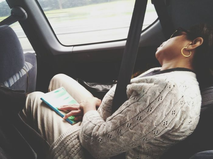 Close-up of woman sleeping in moving car
