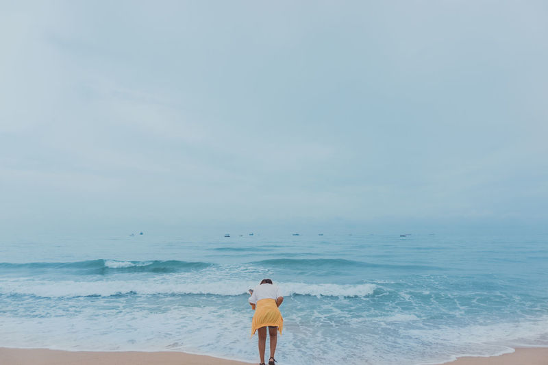Summer Vacation and Travel Concept. Asian Female Stand on Beach Beach Beauty In Nature Day Horizon Horizon Over Water Land Leisure Activity Lifestyles Nature One Person Real People Rear View Scenics - Nature Sea Sky Standing Tranquil Scene Tranquility Water