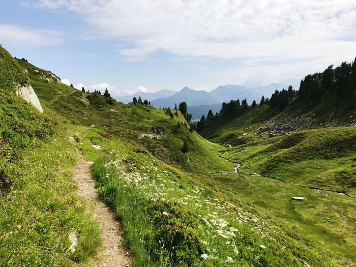 Alps Hiking Trail Path Mountain Nature Sky Beauty In Nature Tranquil Scene Scenics Tranquility Green Color Landscape Grass Mountain Range Cloud - Sky No People Outdoors Day Slope