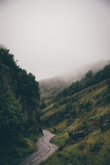 Road leading through Cheddar Gorge in Somerset, United Kingdom. Beauty In Nature Country Road Countryside Day Grass Green Color Hill Landscape Mountain Mountain Range Nature No People Non-urban Scene Outdoors Remote Road Scenics Tranquil Scene Tranquility